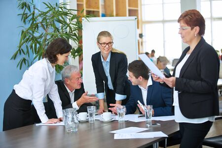 Successful business people discuss together as a team in the meeting