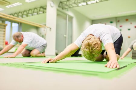 Seniors stretching and stretching in back exercises or physiotherapy