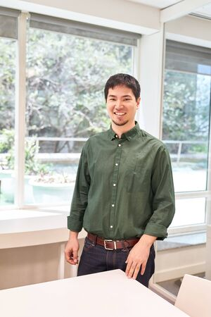 Young man as self-confident trainee or intern in the office or seminar Stock Photo