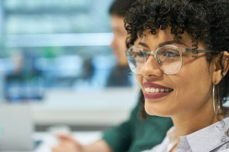 Young African woman as a business trainee or student in multicultural team