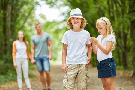 Siblings Children and parents go on a nature trip