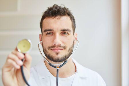 Doctor with stethoscope listening in practice Banco de Imagens
