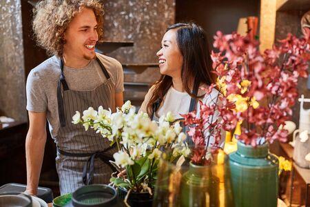 Florist team is retailing together in flower shop