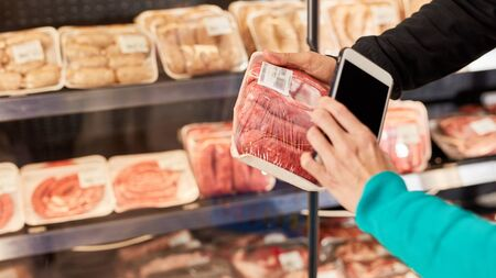 Customers use smartphone app with barcode scanner when purchasing meat