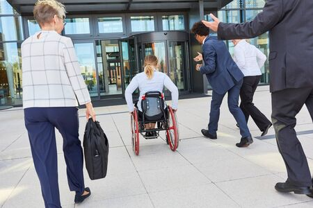 Business people run next to businesswoman in wheelchair to congress or office