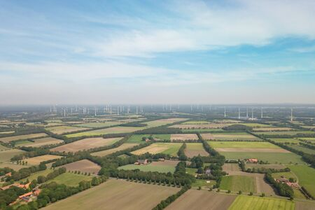 Field of windmills with blue sky in countryside of Munsterland, Germany Imagens