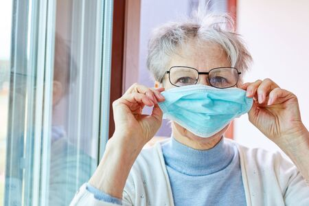 Senior woman in quarantine mouthguard as a Covid-19 patient Stock Photo