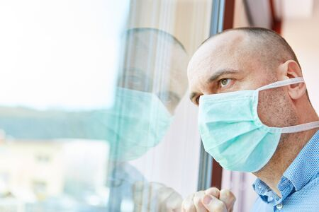 Senior with face mask as a risk group in home quarantine in Covid-19 epidemic