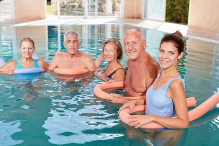 Seniors in the water in the rehab group for hydrotherapy in the swimming pool