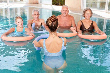 Seniors do healthy back exercises with aquagym exercises