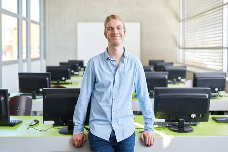 IT student in computer science course smiles happy