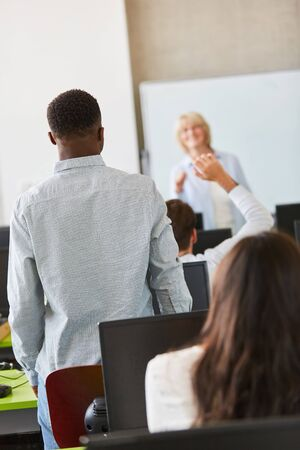 Pupils or students learn in seminar class with teacher