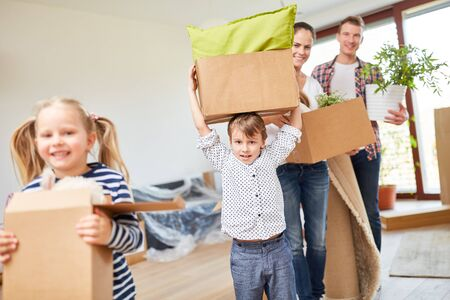 Children enjoy moving and carry boxes with their parents