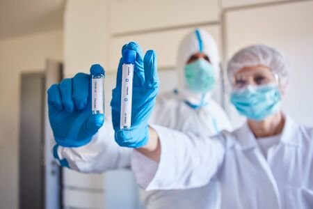 Covid-19 rapid test and vaccine in coronavirus crisis with researchers in the laboratory