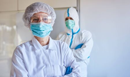 Doctor and nurse in hospital with protective clothing for coronavirus and Covid-19 pandemic