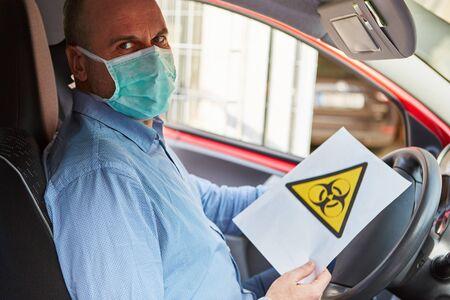 Biohazard driver warning of Covid-19 coronavirus pandemic