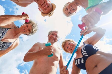 Vital seniors in summer vacations enjoy fitness and exercise together