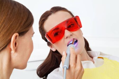 Tooth whitening through laser therapy at the dentist Archivio Fotografico