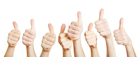 Many different thumbs point up together Stockfoto