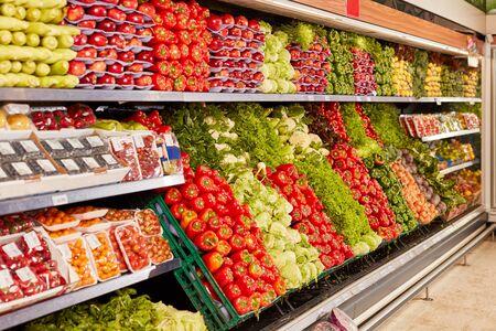Many varieties of vegetables in the supermarket shelf as a symbol of healthy food Stock fotó
