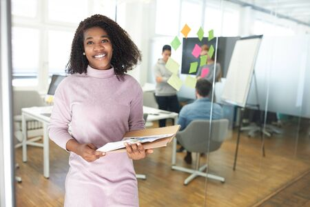 Young African business woman as a start-up founder with documents in the office
