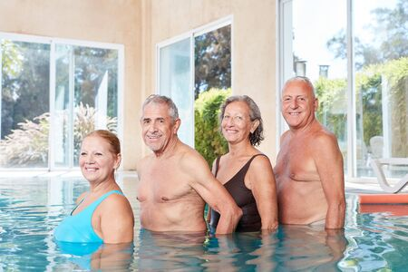 Group of seniors in the swimming pool make aquagym in rehab Archivio Fotografico