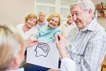 Female doctor and senior citizen with a sketch of the brain makes health education