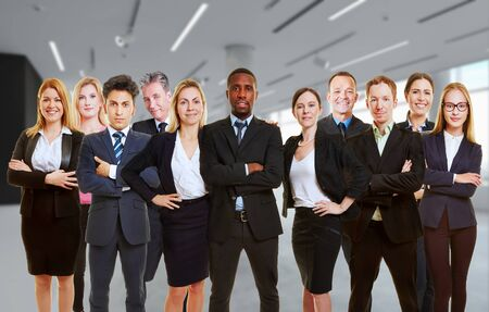 Team of business people in teamwork standing as group in office (3D Rendering) Archivio Fotografico