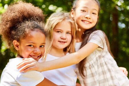 Three multicultural girls together for friendship and integration