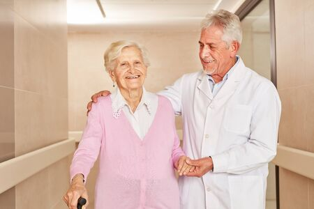 Happy senior citizen as a disabled patient and a caring doctor