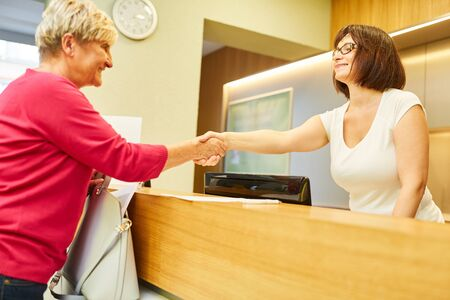 Patient greeted with a handshake at the reception of the doctor's office or physiotherapy