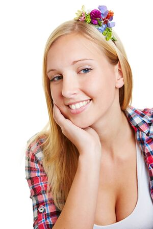 Young blonde smiling woman with flower hair accessories