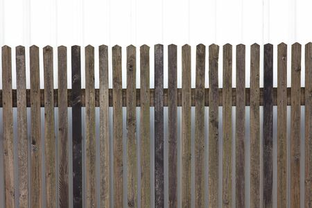 Wooden fence as a barrier against a wall Reklamní fotografie