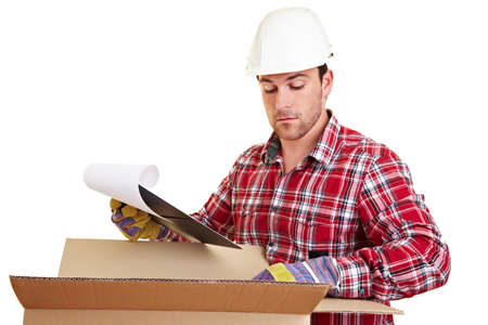 Warehouse worker checks delivery note with checklist on delivery Archivio Fotografico - 150631179