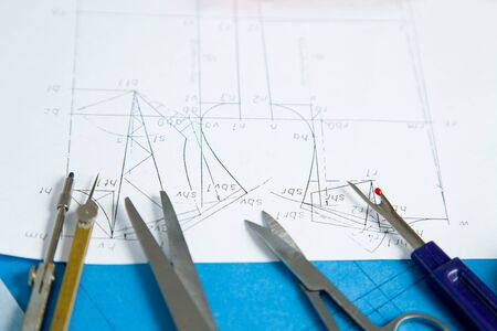 Sewing pattern for a dress with tools such as scissors and compasses