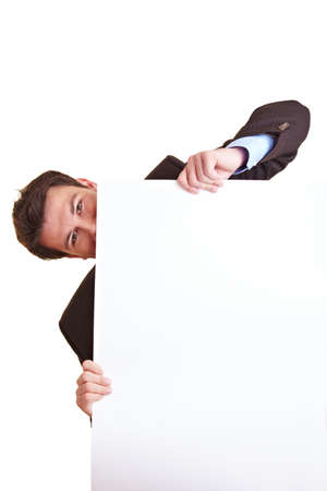 Businessman is hiding behind a white poster