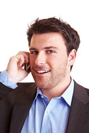 Satisfied businessman is talking on his cell phone