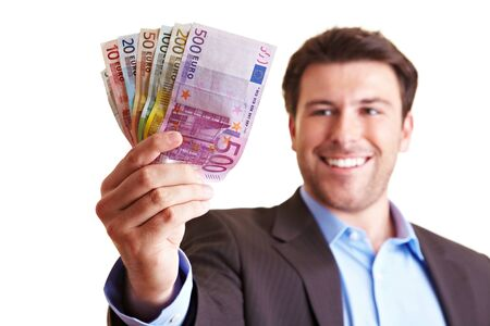 Successful manager shows a fan of money from euro bills Banque d'images