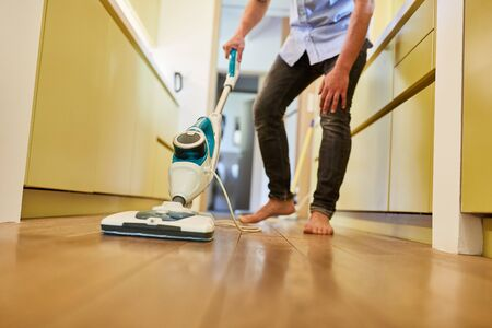 Cleaning power with steam cleaner for parquet and floor cleaning in the hallway Stockfoto