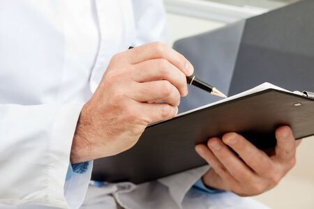 Hygiene inspector when working with clipboard Stockfoto
