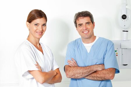 Two happy doctors with crossed arms