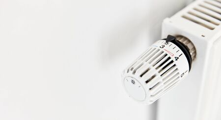 Temperature regulator with thermostat on radiator from a white heater