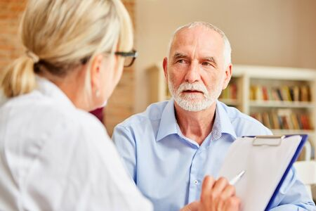 Senior patient listens to his doctor attentively during consultation