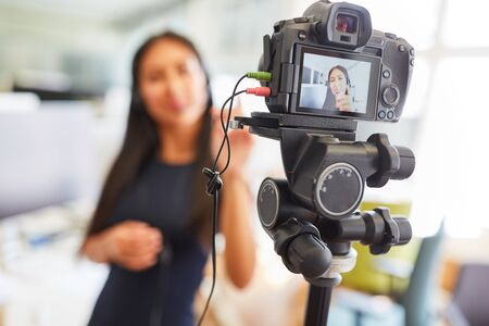 Business woman recording a video for a streaming tutorial or an interview on the Internet Archivio Fotografico - 150512913