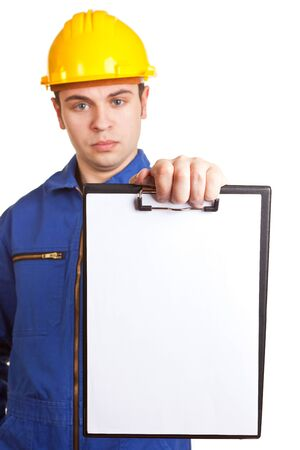 Craftsman in overalls with hard hat holds list of defects on clipboard