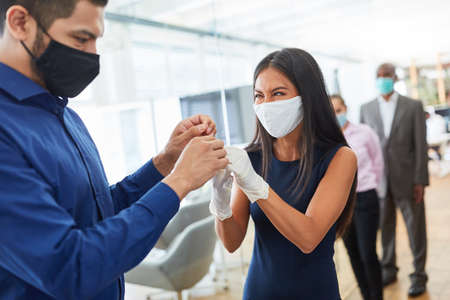 Disinfection of the hands of business people as protection from the office because of Covid-19 and corona virus