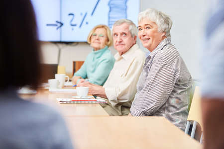 Group of seniors with financial advice on retirement provision and investment