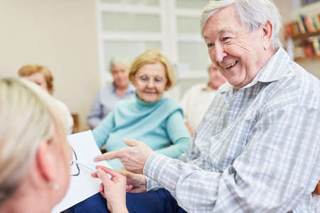 Senior man receives health advice from a doctor in a nursing home