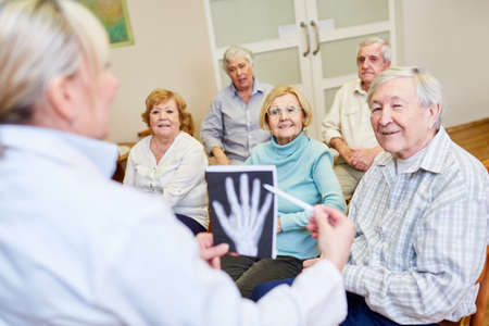 Doctor takes a health course for senior citizens in a retirement home or retirement home Stock fotó