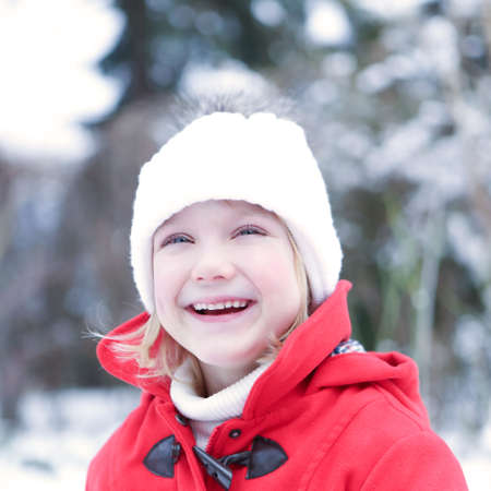 Laughing child outside in winter with snow